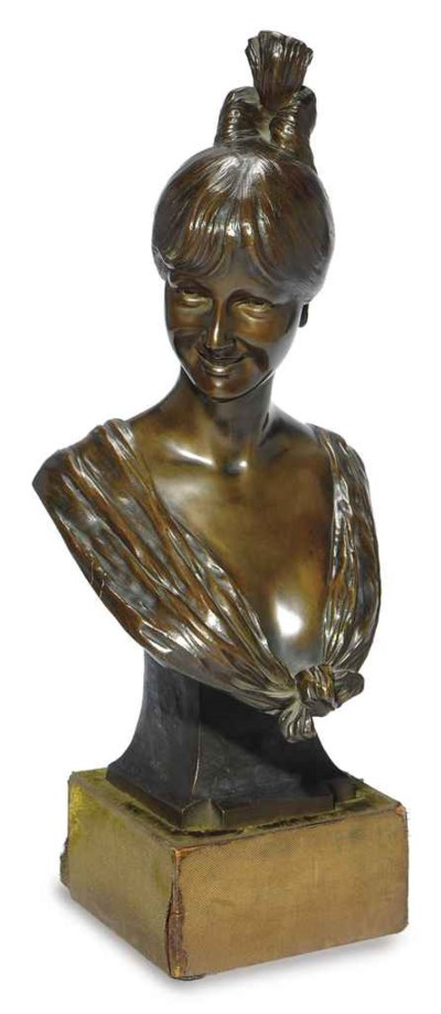 A GERMAN BRONZE BUST OF A GIRL