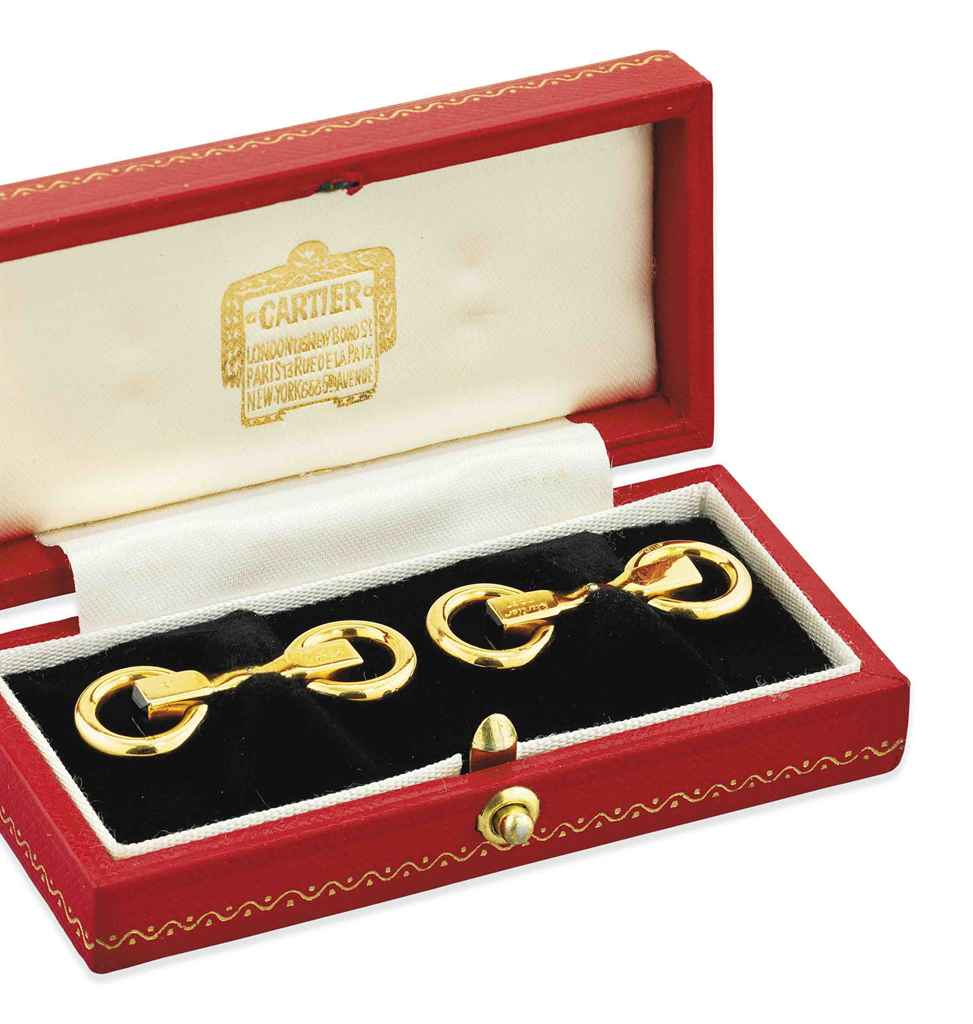 A pair of 18ct. gold and sapphire cufflinks, by Cartier