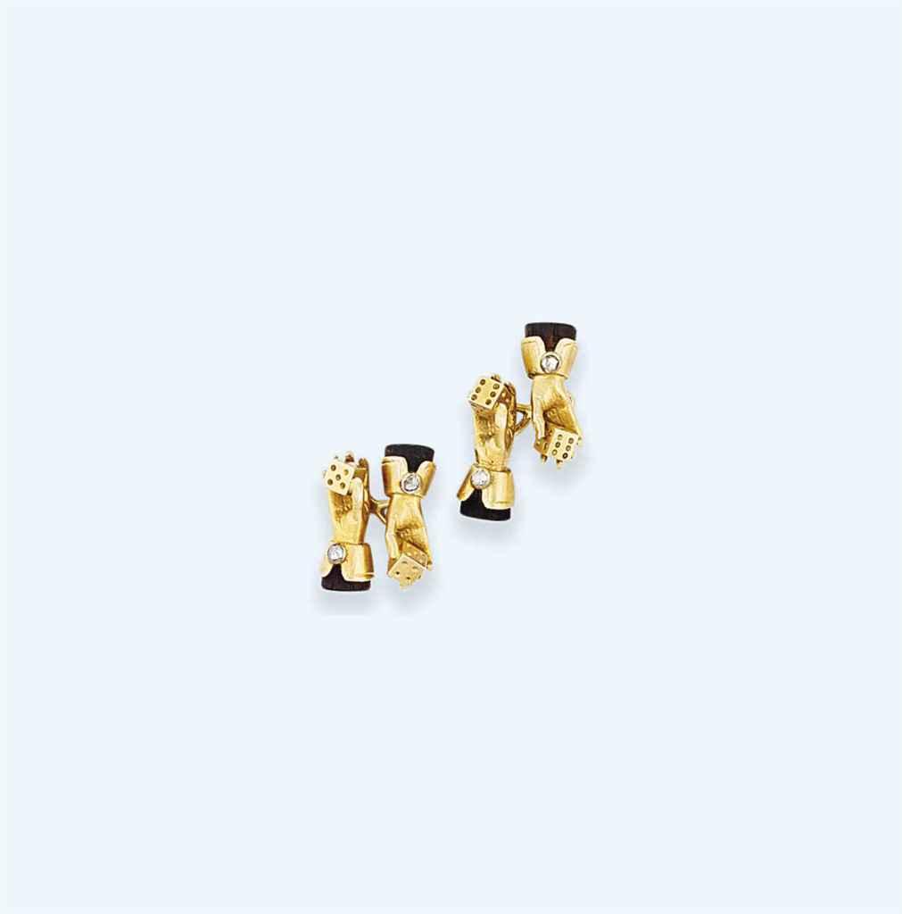 A pair of ebony and diamond set cufflinks