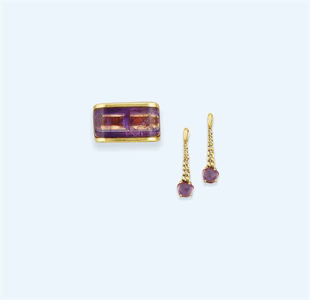 An amethyst ring, by Gucci and a pair of amethsyt earrings, by Pomelatto