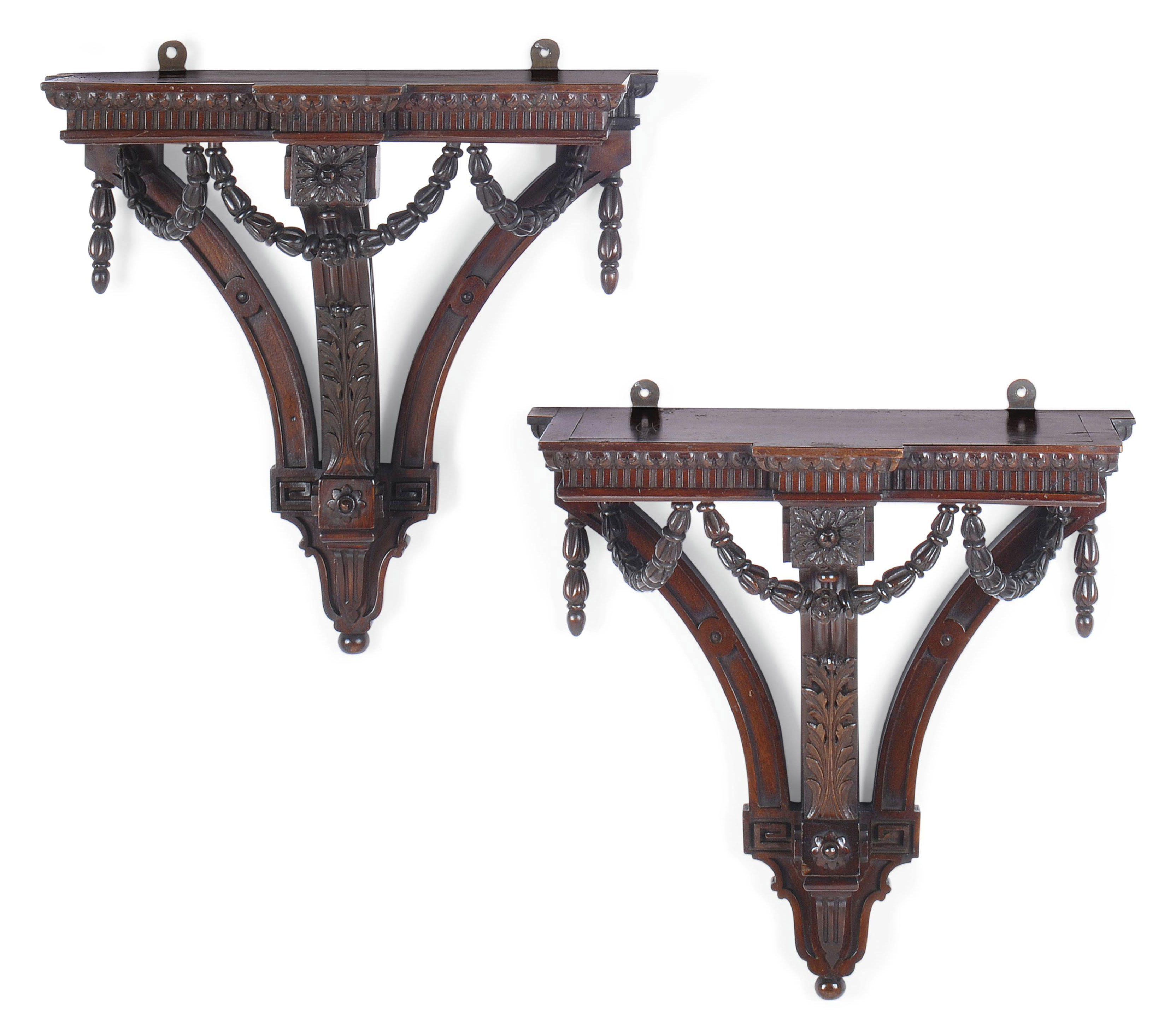 A PAIR OF CARVED MAHOGANY WALL BRACKETS