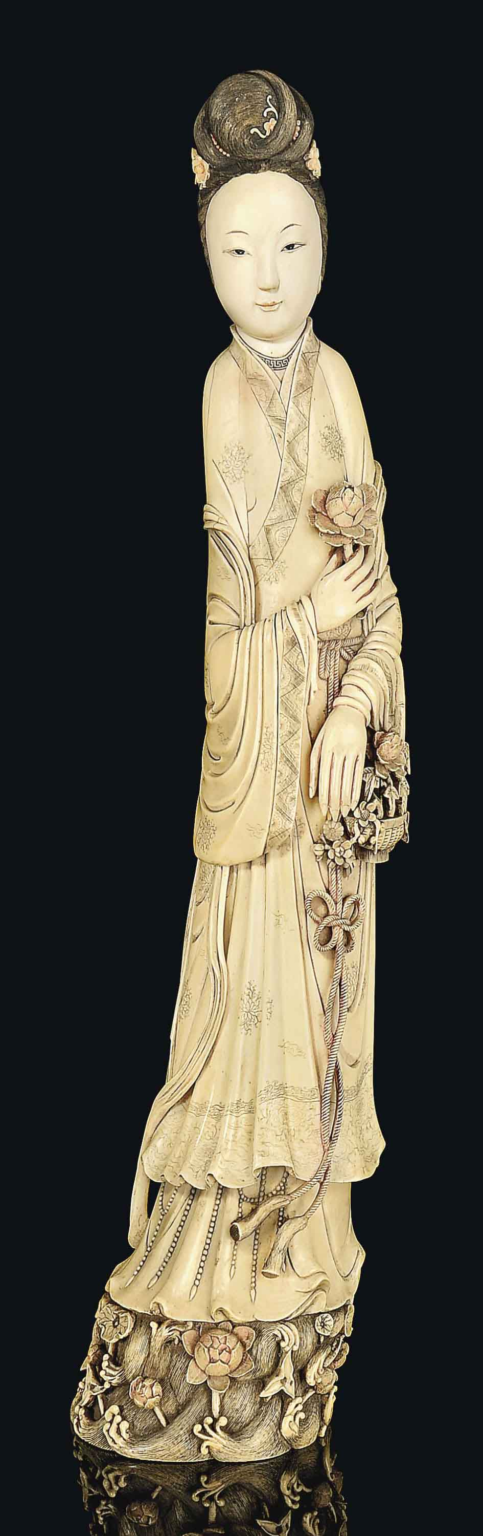 A PAINTED IVORY FIGURE OF A MAIDEN