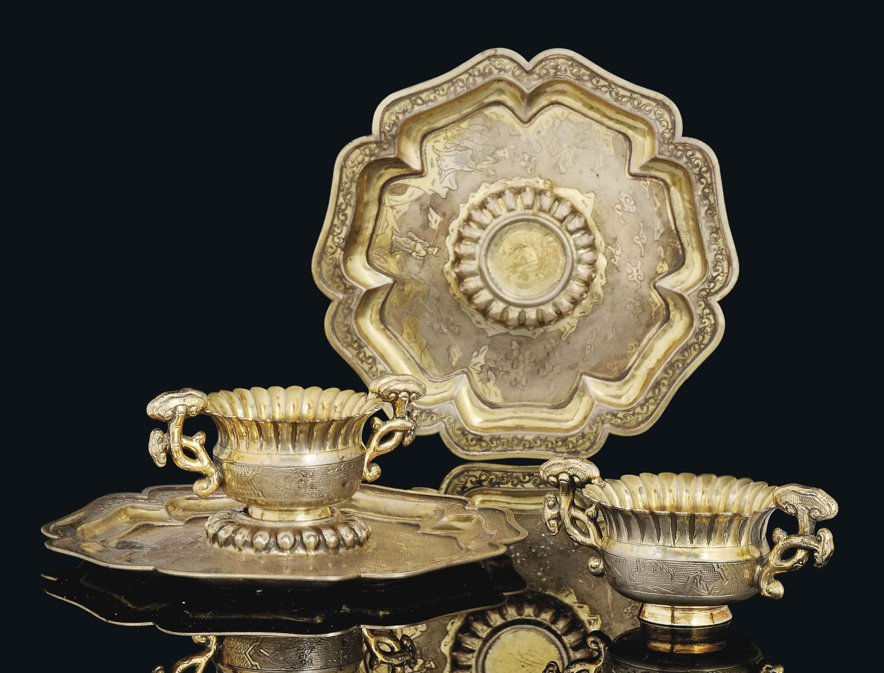 A PAIR OF PARCEL-GILT SILVER CUPS AND CUP-STANDS