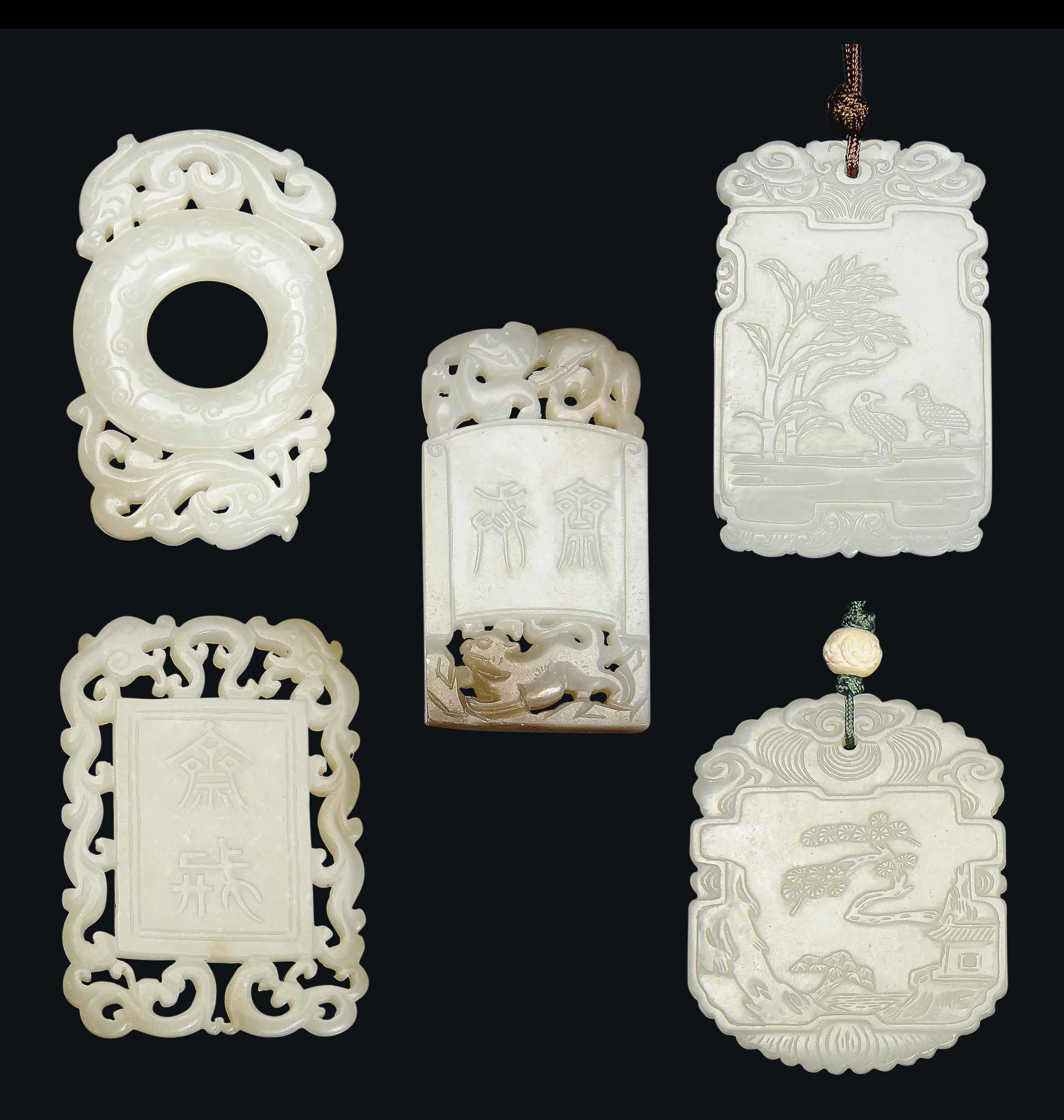 FIVE WHITE AND PALE CELADON JADE PENDANTS