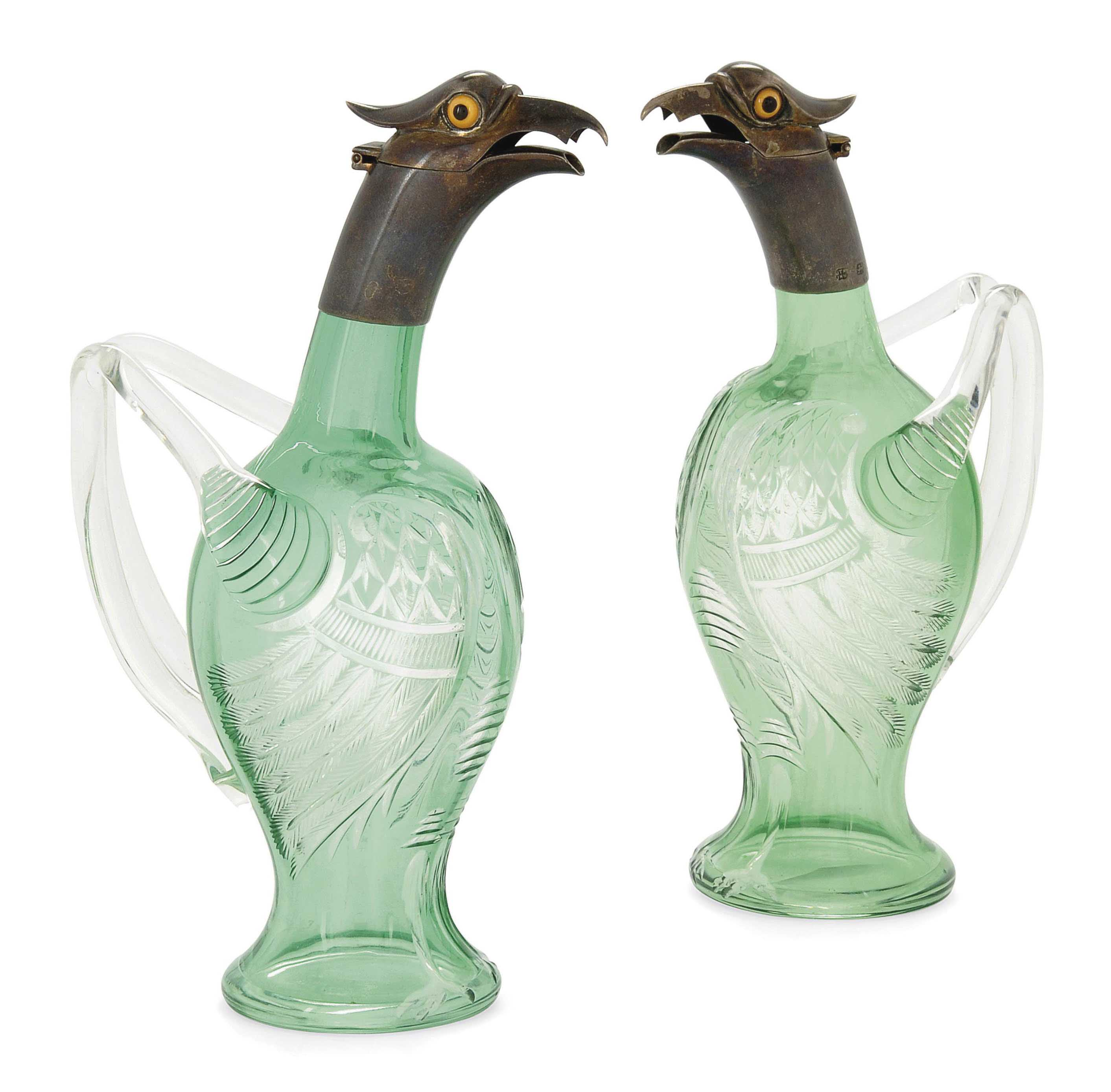 A PAIR OF VICTORIAN NOVELTY SILVER-MOUNTED SPIRIT JUGS