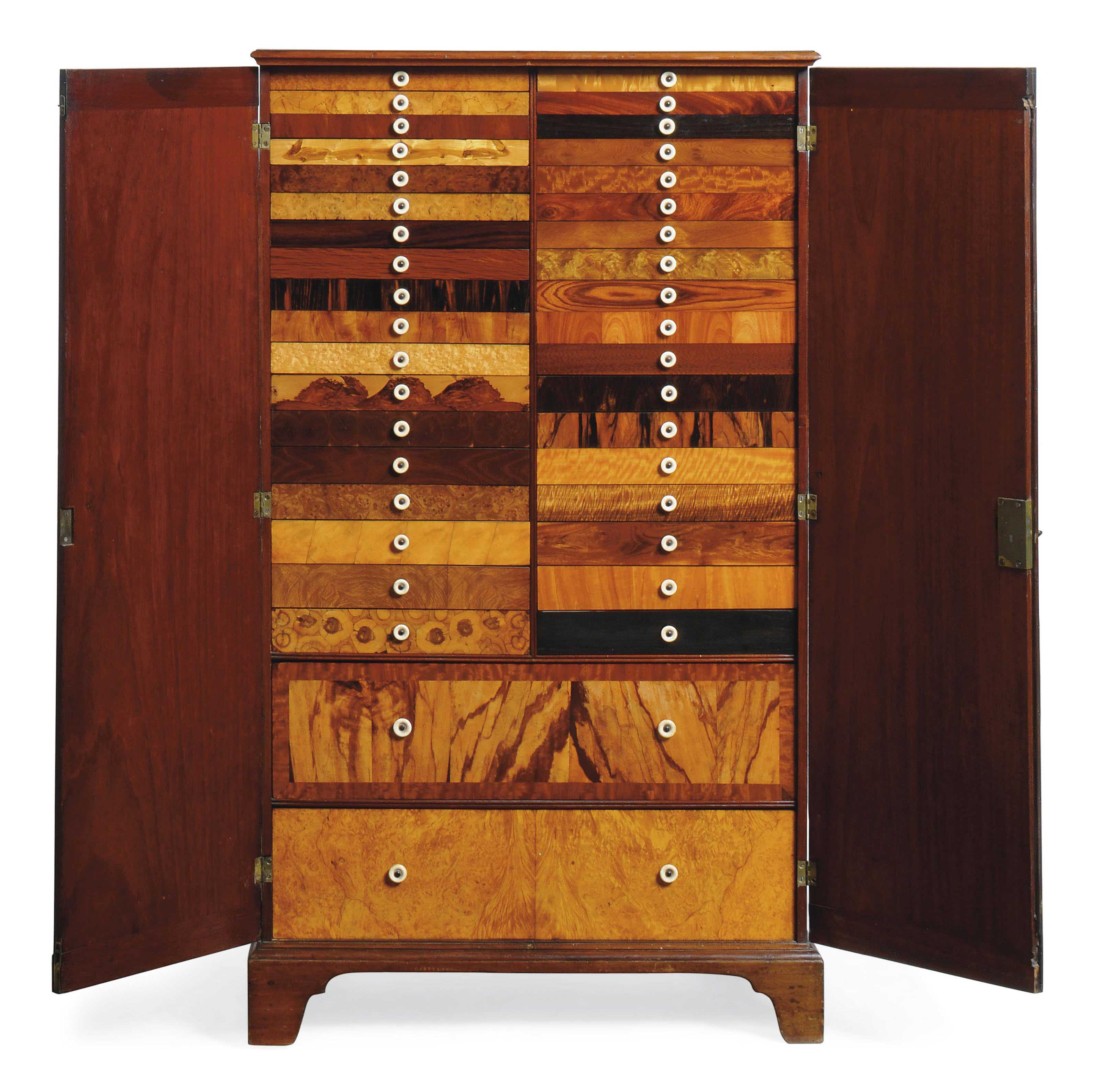 A REGENCY MAHOGANY AND SPECIMEN WOOD COLLECTOR'S CABINET