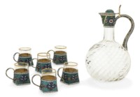 A RUSSIAN SILVER-GILT AND CLOISONNE ENAMEL VODKA JUG WITH 6 VODKA CUPS EN SUITE