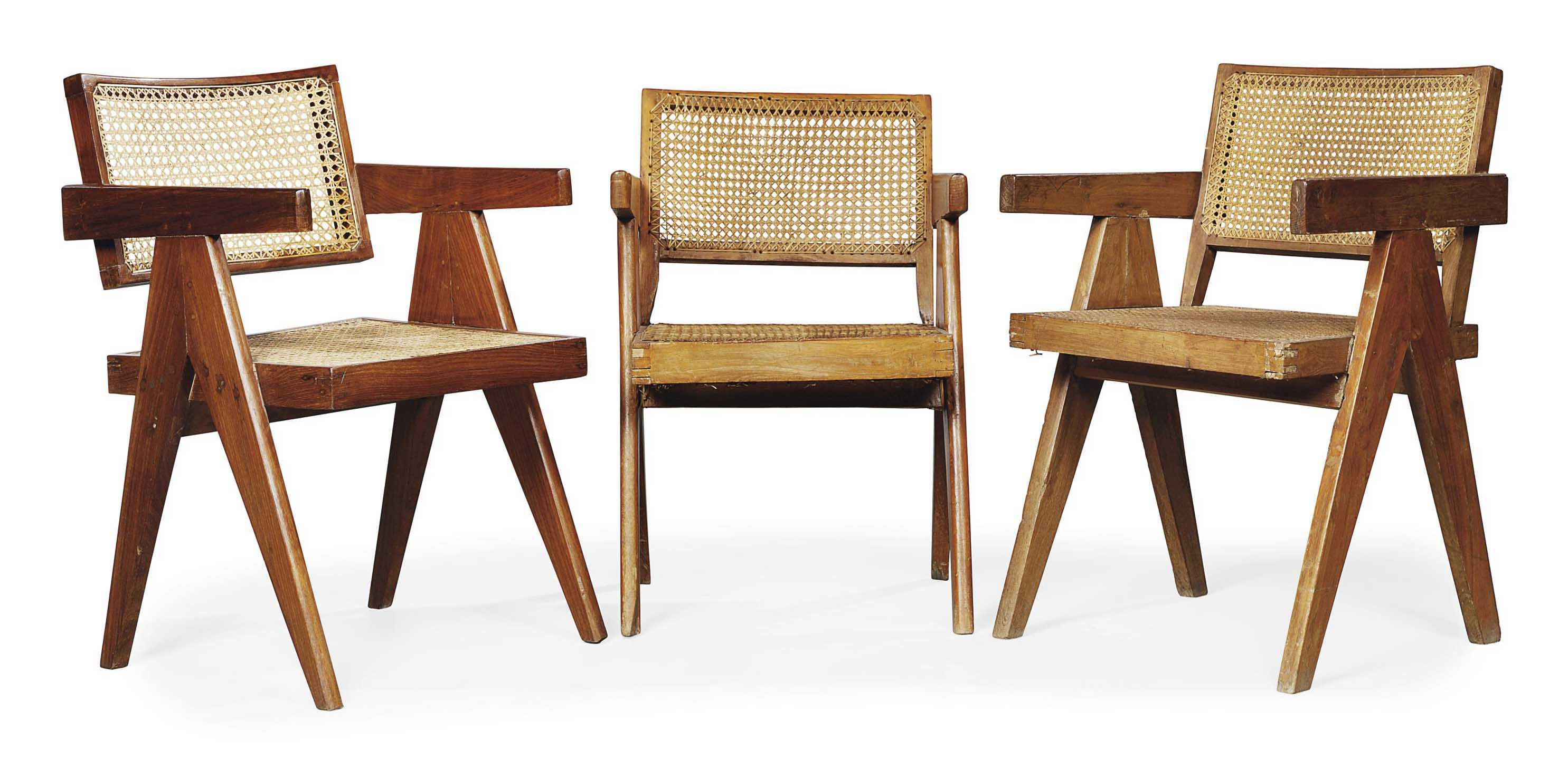 A SET OF THREE PIERRE JEANNERET TEAK AND CANEWORK 'CONFÉRENCE' ARMCHAIRS