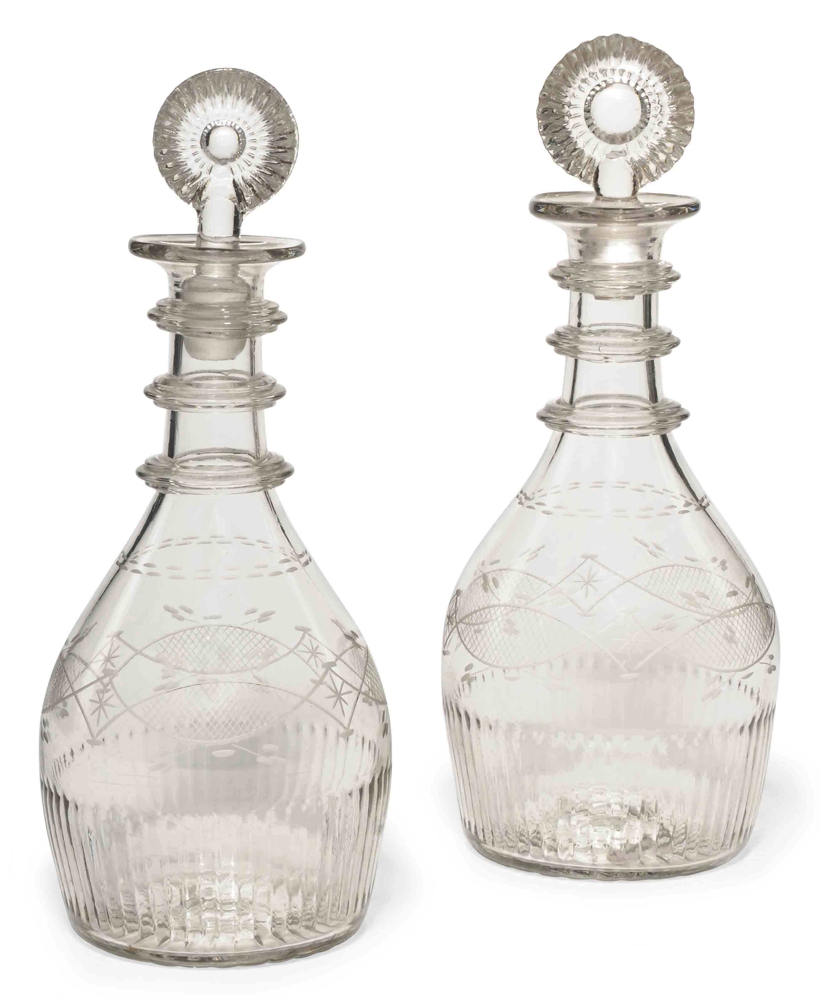 A PAIR OF IRISH (WATERLOO GLASS CO.) DECANTERS AND STOPPERS