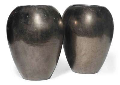 A PAIR OF SILVER-GLAZED POTTER