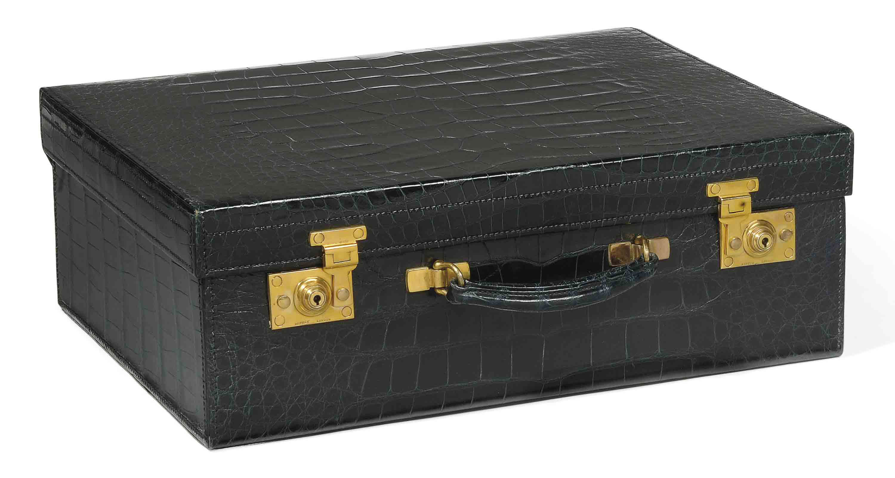 A NAVY BLUE CROCODILE TRAVELLING CASE