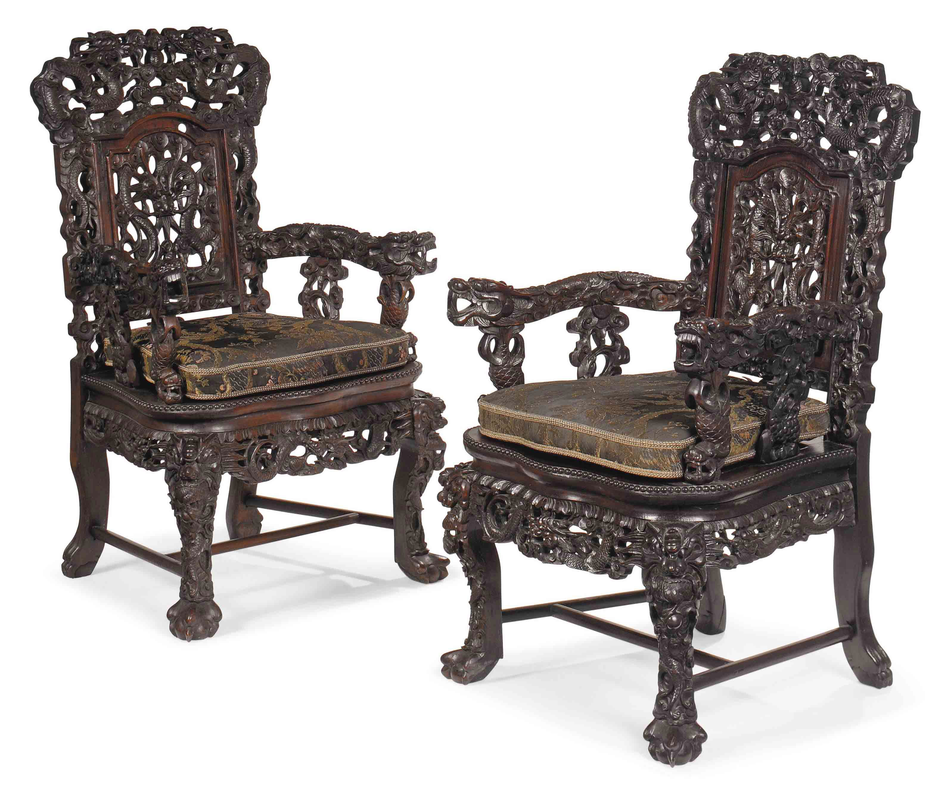 A PAIR OF SOUTH EAST ASIAN HARDWOOD ARMCHAIRS