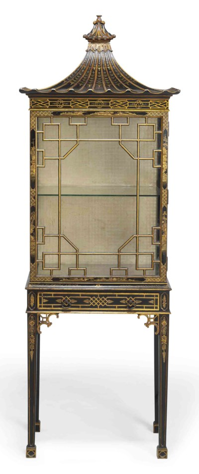 A BLACK AND GILT JAPANNED CHIN