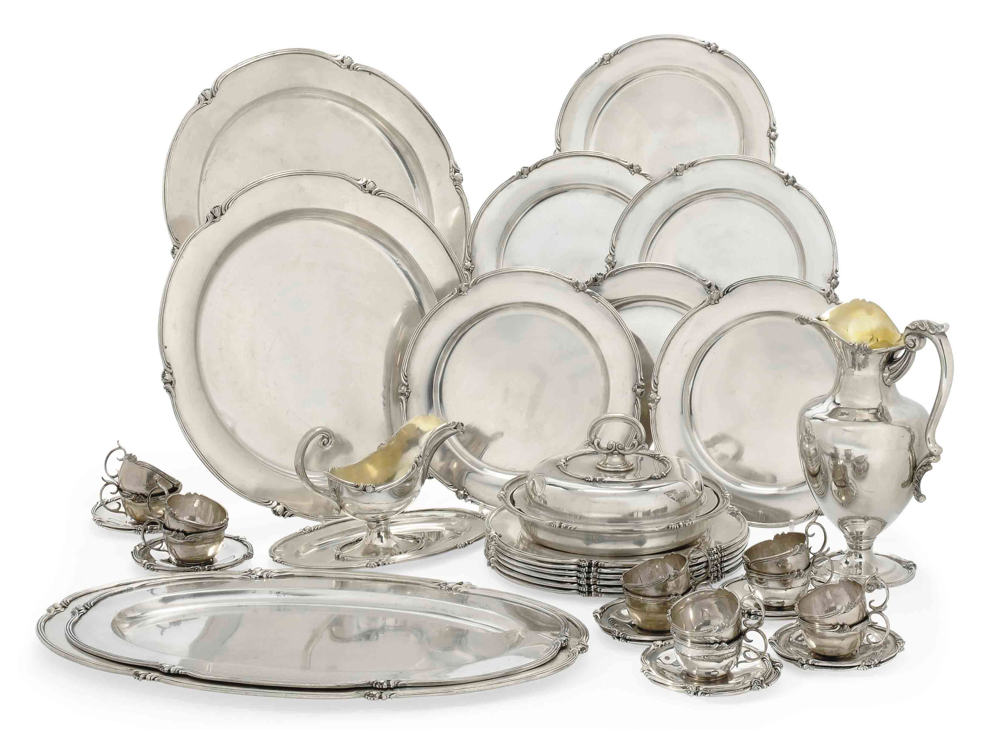 A PORTUGESE METALWARE DINNER S