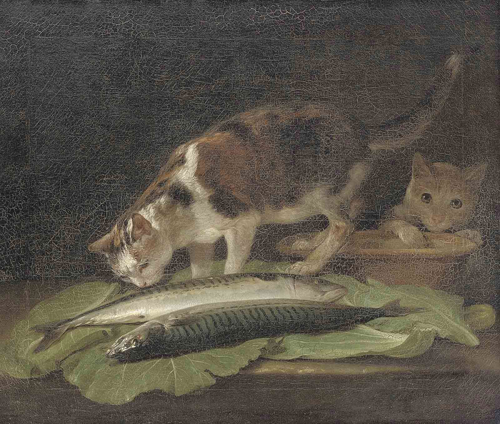 Two cats on a table with an earthenware bowl and two fish
