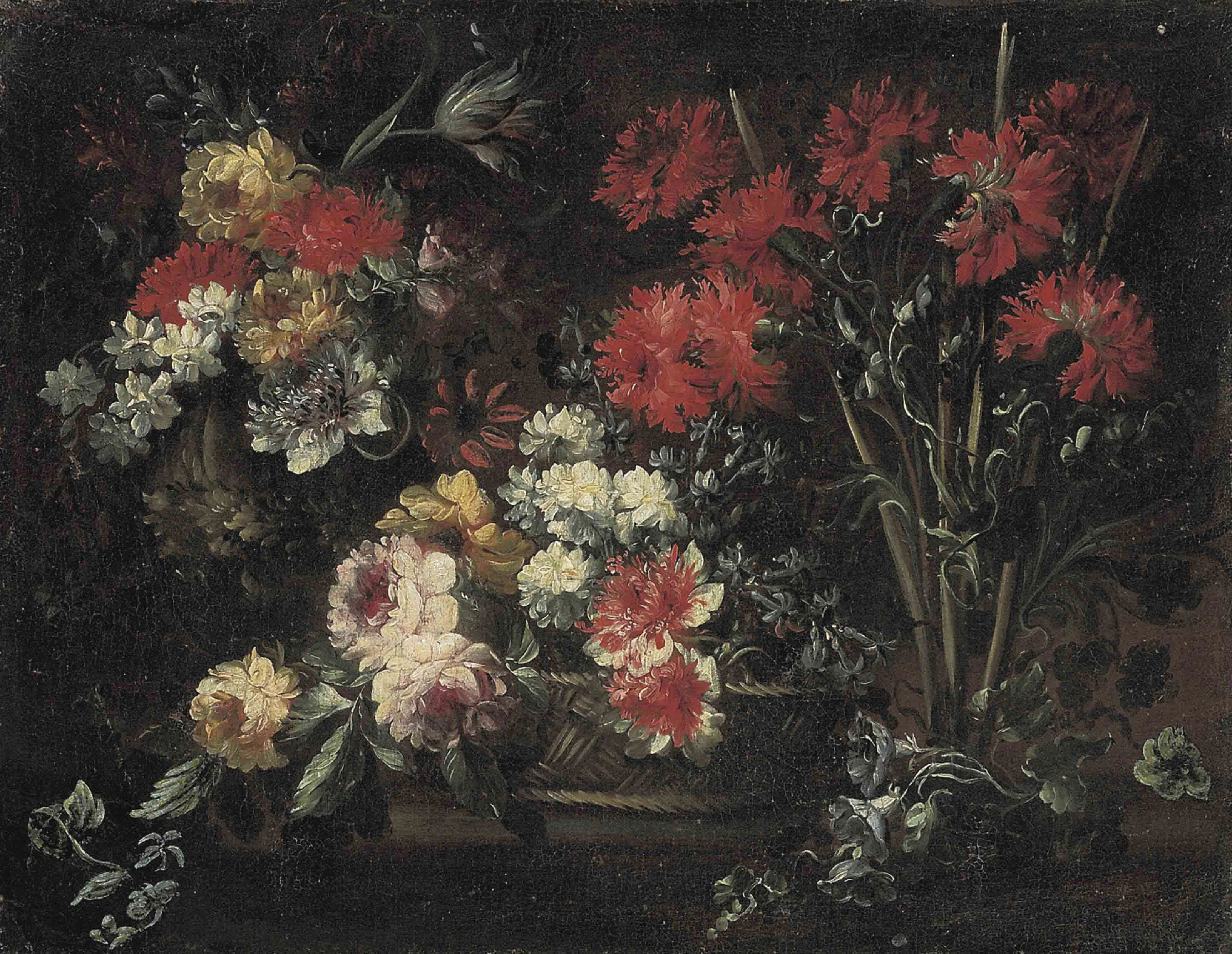 Roses, chrysanthemums and other flowers in a wicker basket, carnations, roses, narcissi and other flowers on a stone ledge