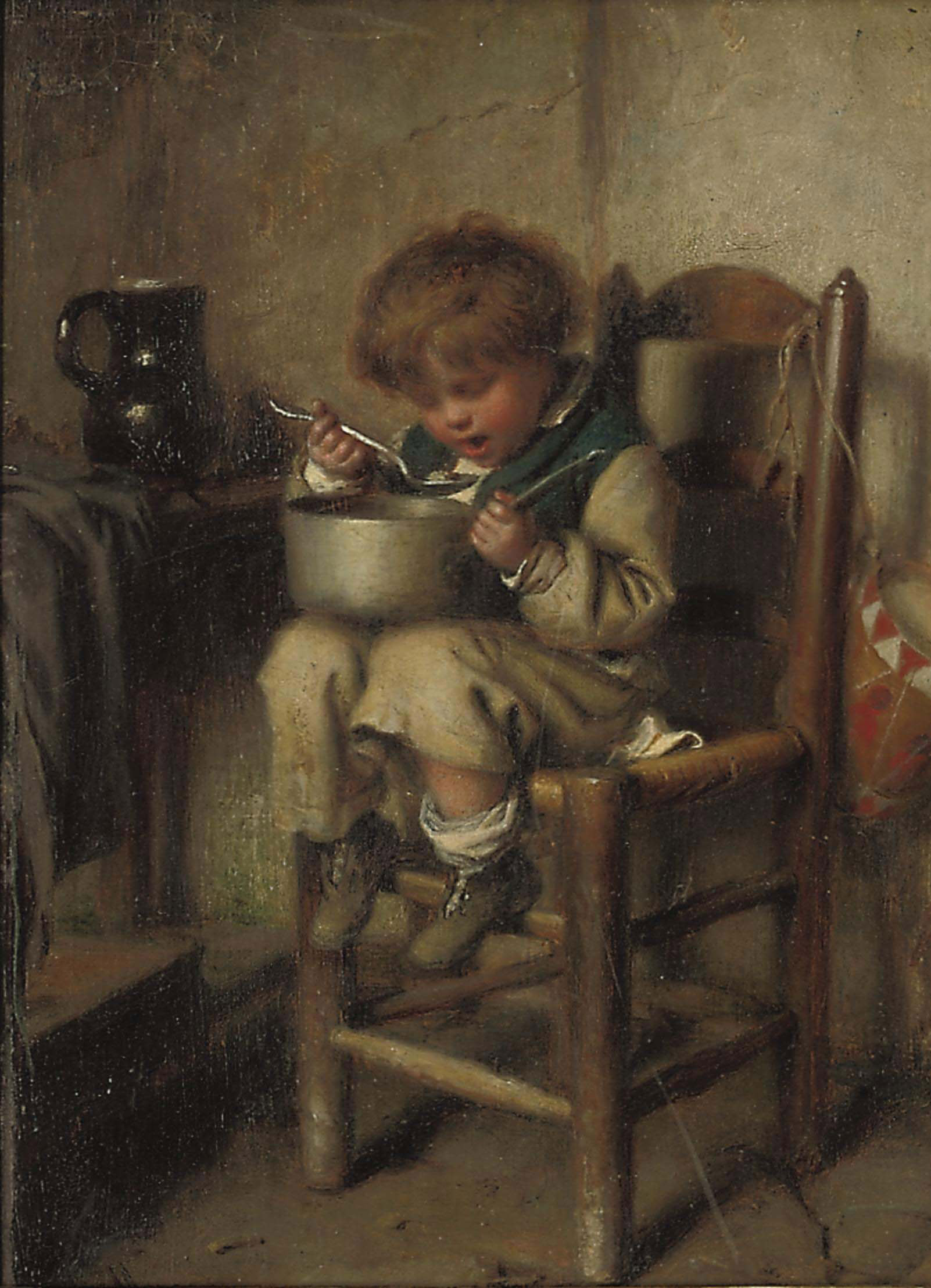 A boy eating porridge