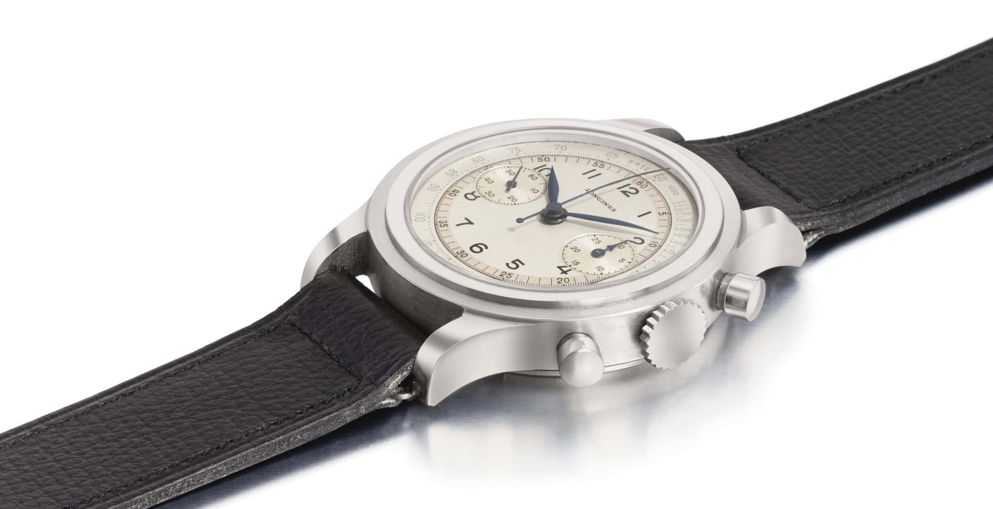 Longines. A large and rare stainless steel chronograph wristwatch with two-tone silvered dial, original metal price tag and box