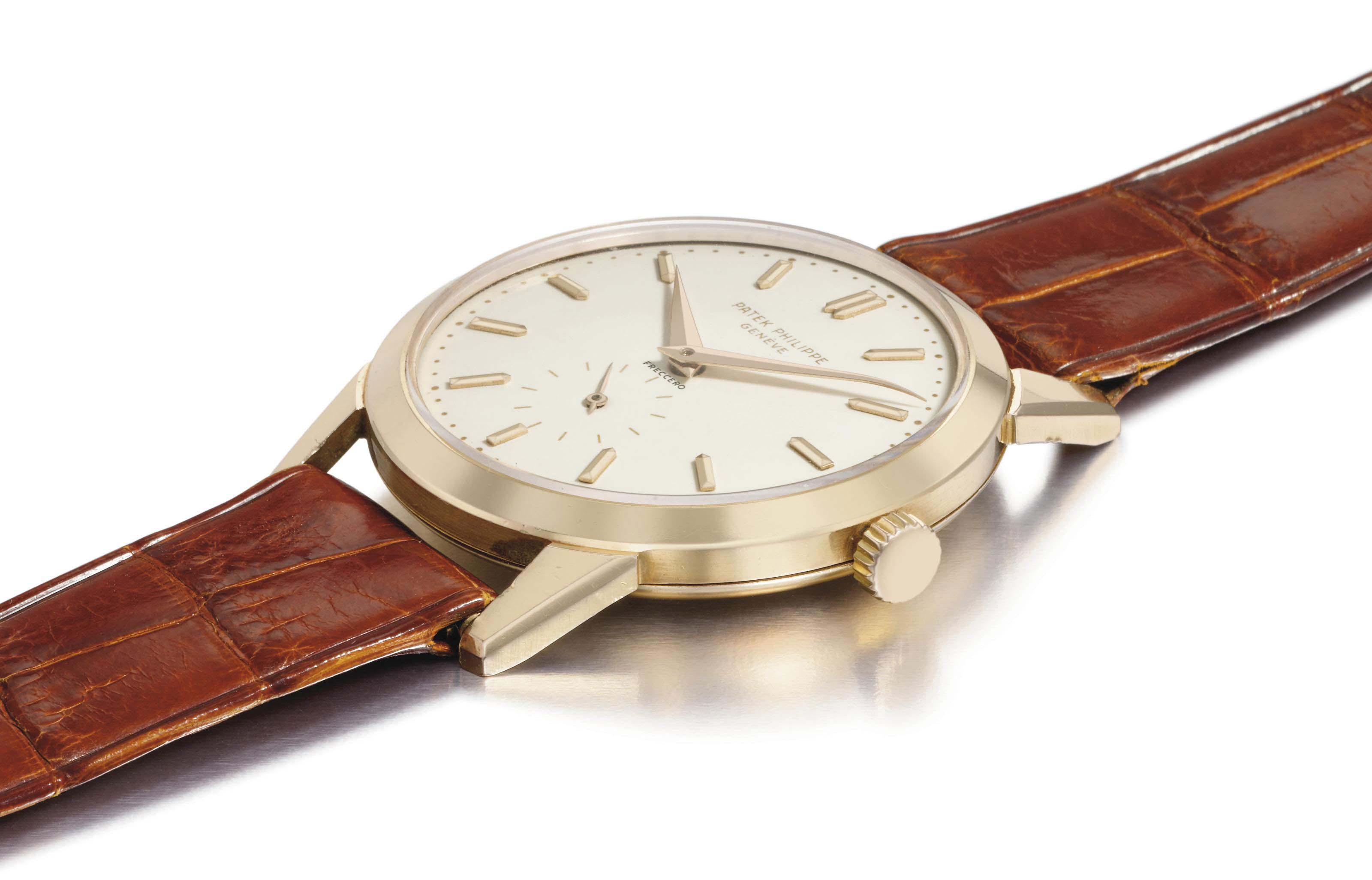 Patek Philippe. A fine and very rare 18K pink gold wristwatch with enamel dial