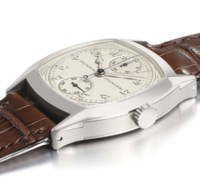 Patek Philippe. An extremely fine, important and possibly unique 18K white gold cushion-shaped single button chronograph wristwatch with vertically positioned register and Breguet numerals