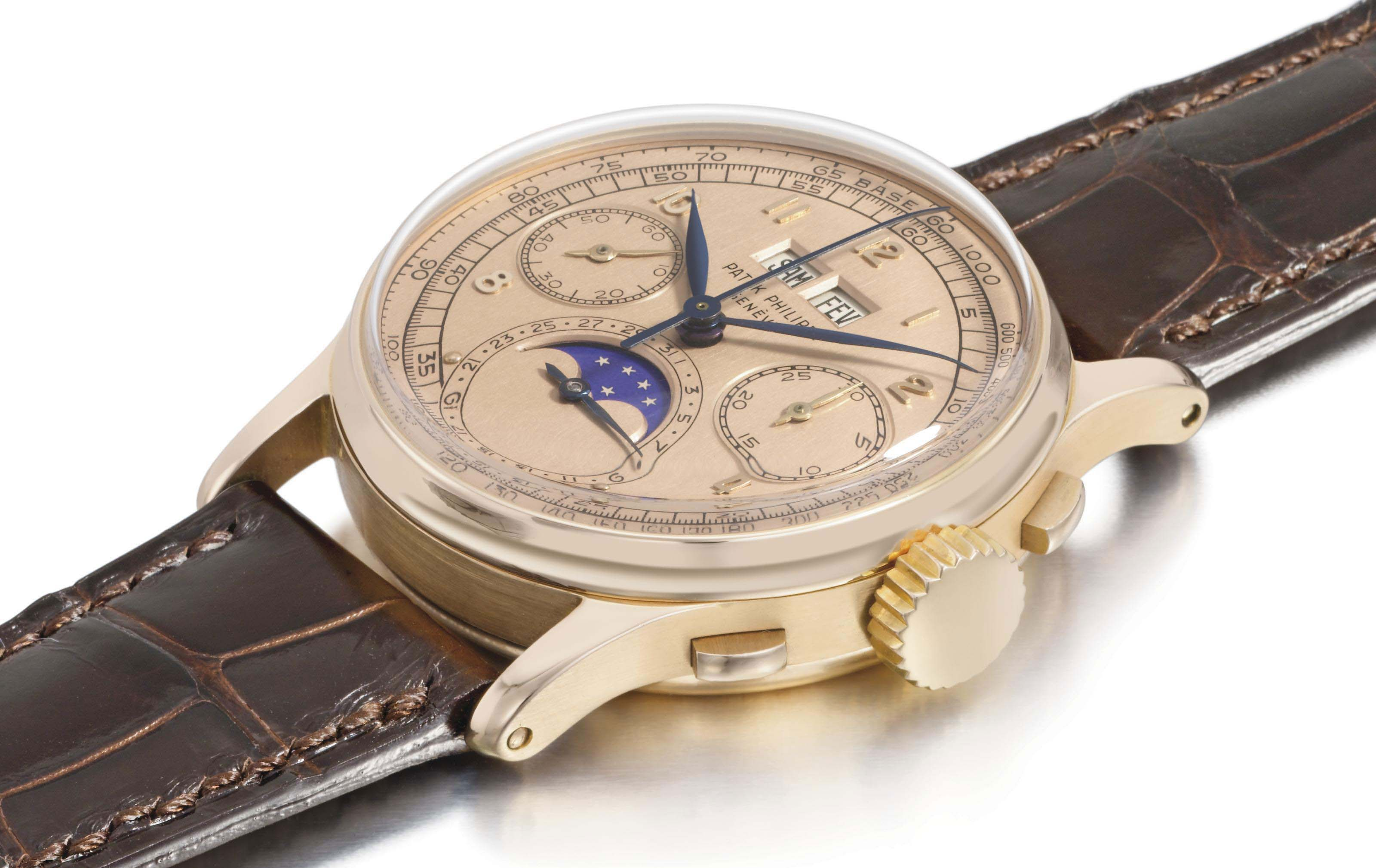 Patek Philippe. An exceptional 18K pink gold perpetual calendar chronograph wristwatch with moon phases and pink dial