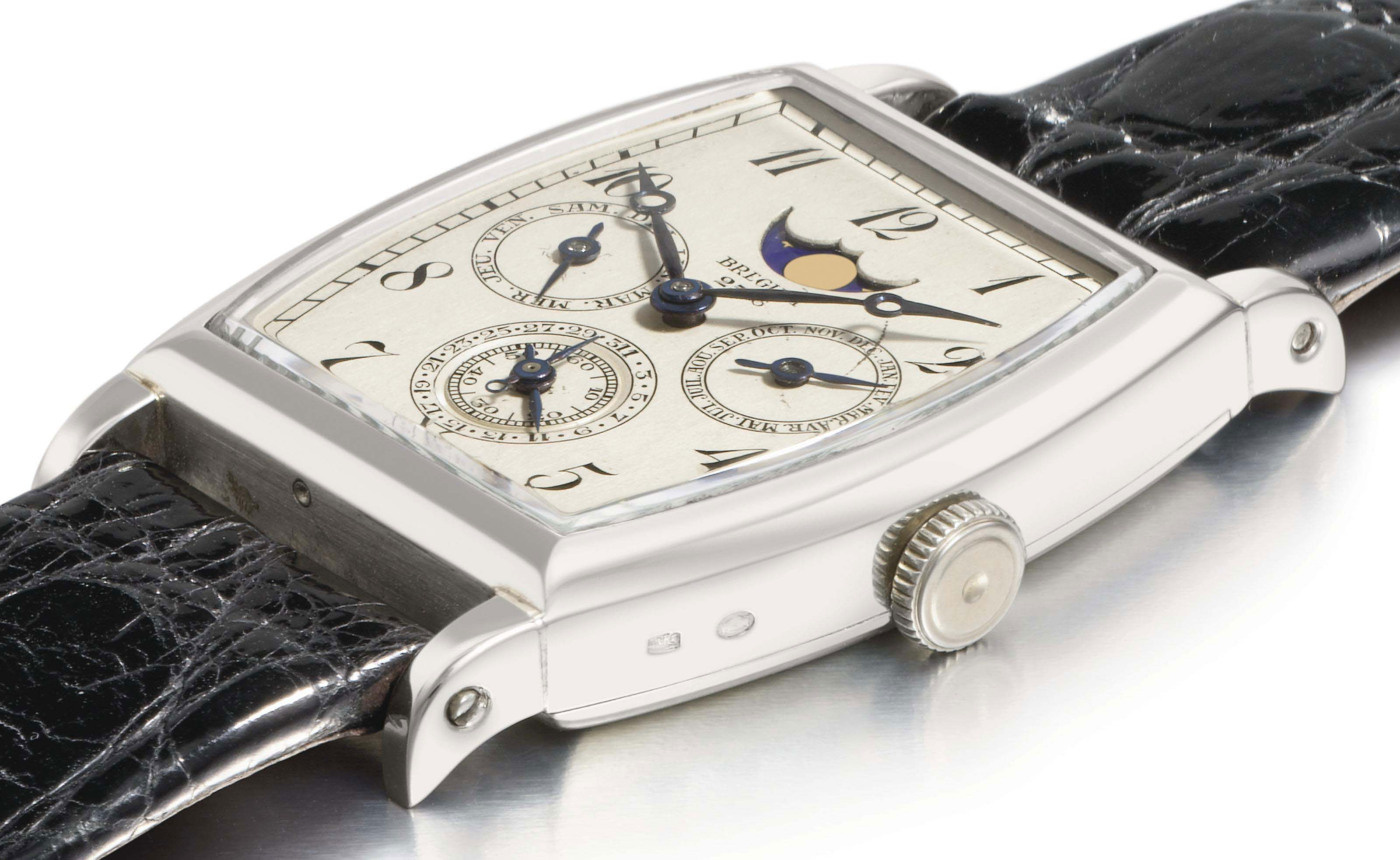 Breguet. A unique and historically important 18K white gold tonneau-shaped wristwatch with instantaneous perpetual calendar and moon phases