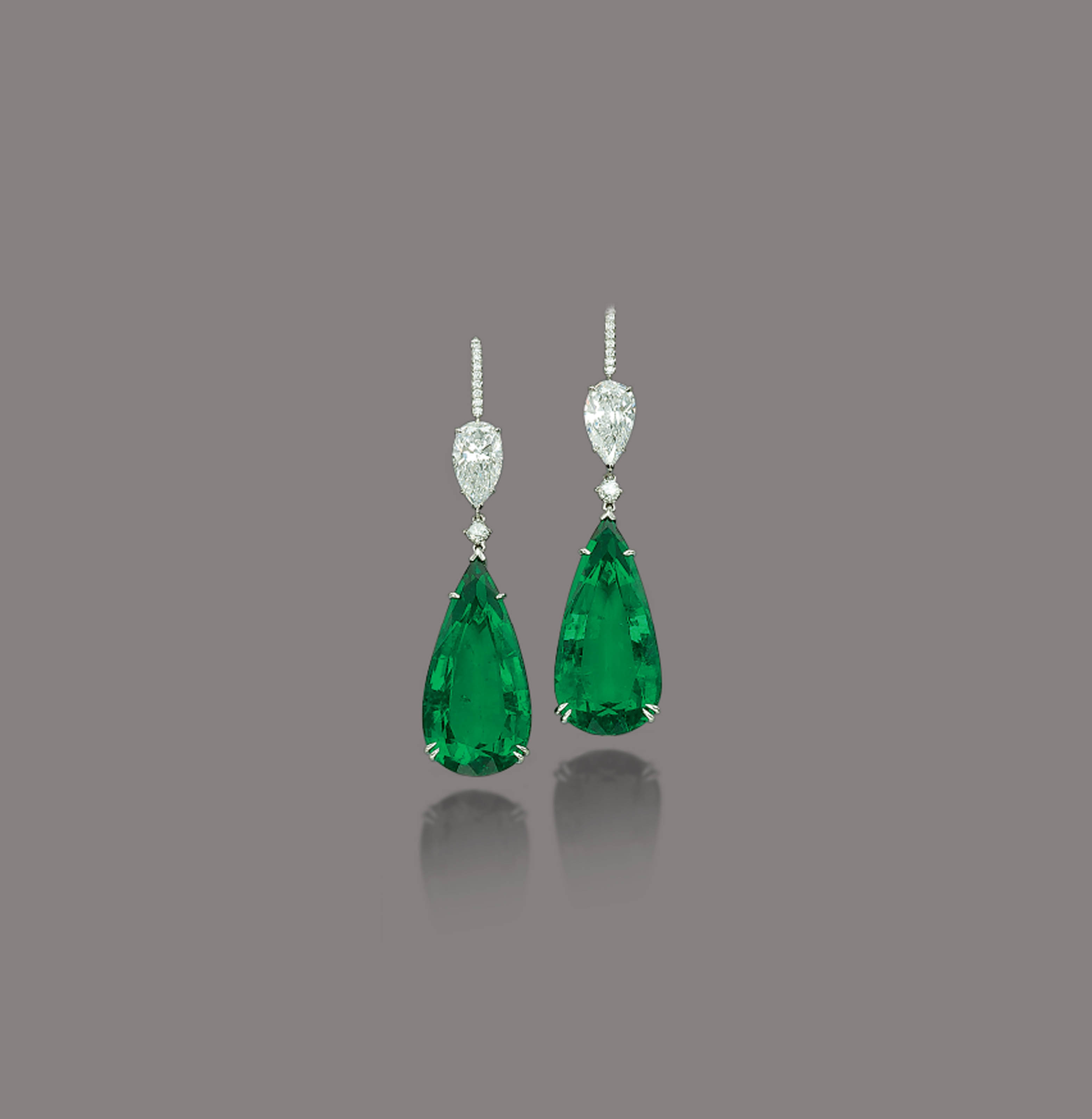 A PAIR OF MAGNIFICENT EMERALD AND DIAMOND EARRINGS
