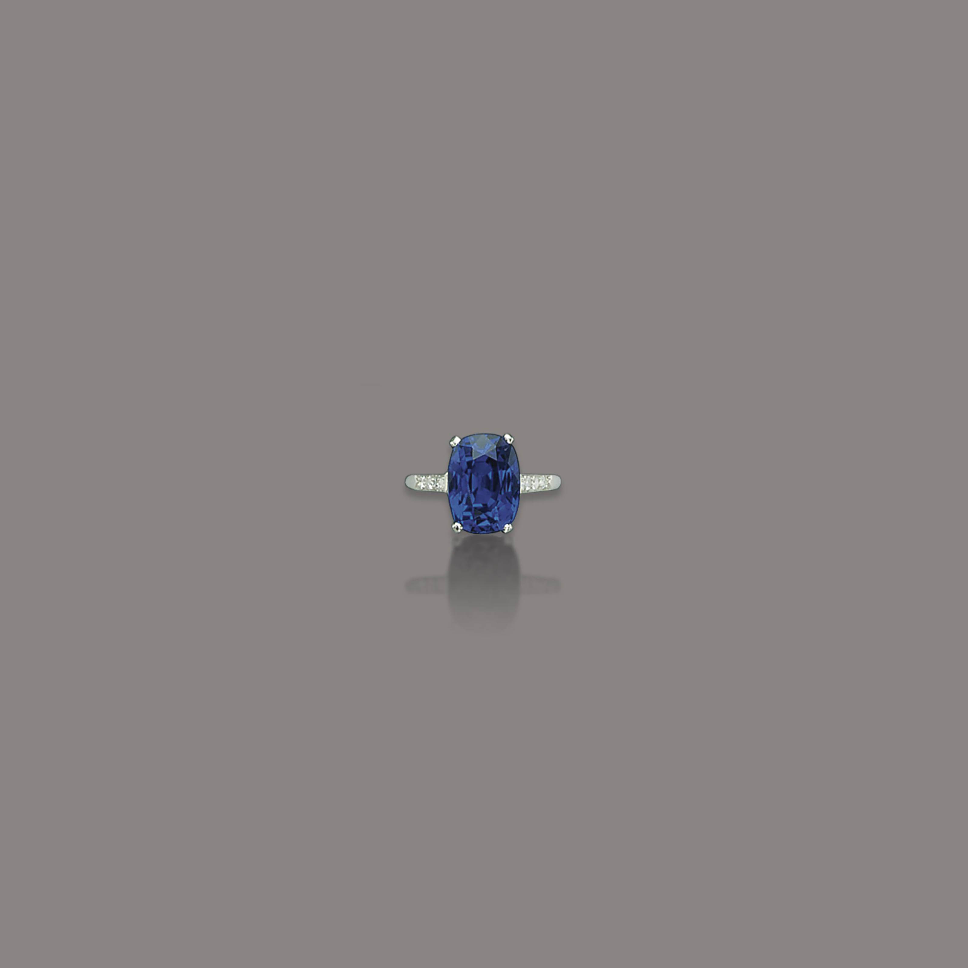 A SAPPHIRE AND DIAMOND RING, BY CARTIER