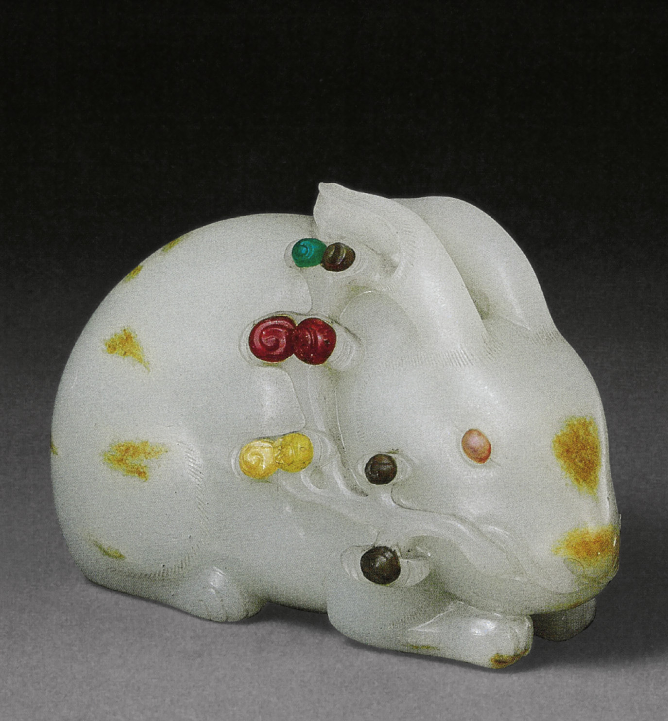 AN EXQUISITE AND VERY RARE WHITE JADE HORSE GROUP