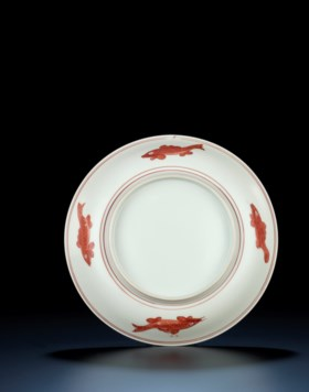 A RARE MING IRON-RED DECORATED 'FISH' DISH