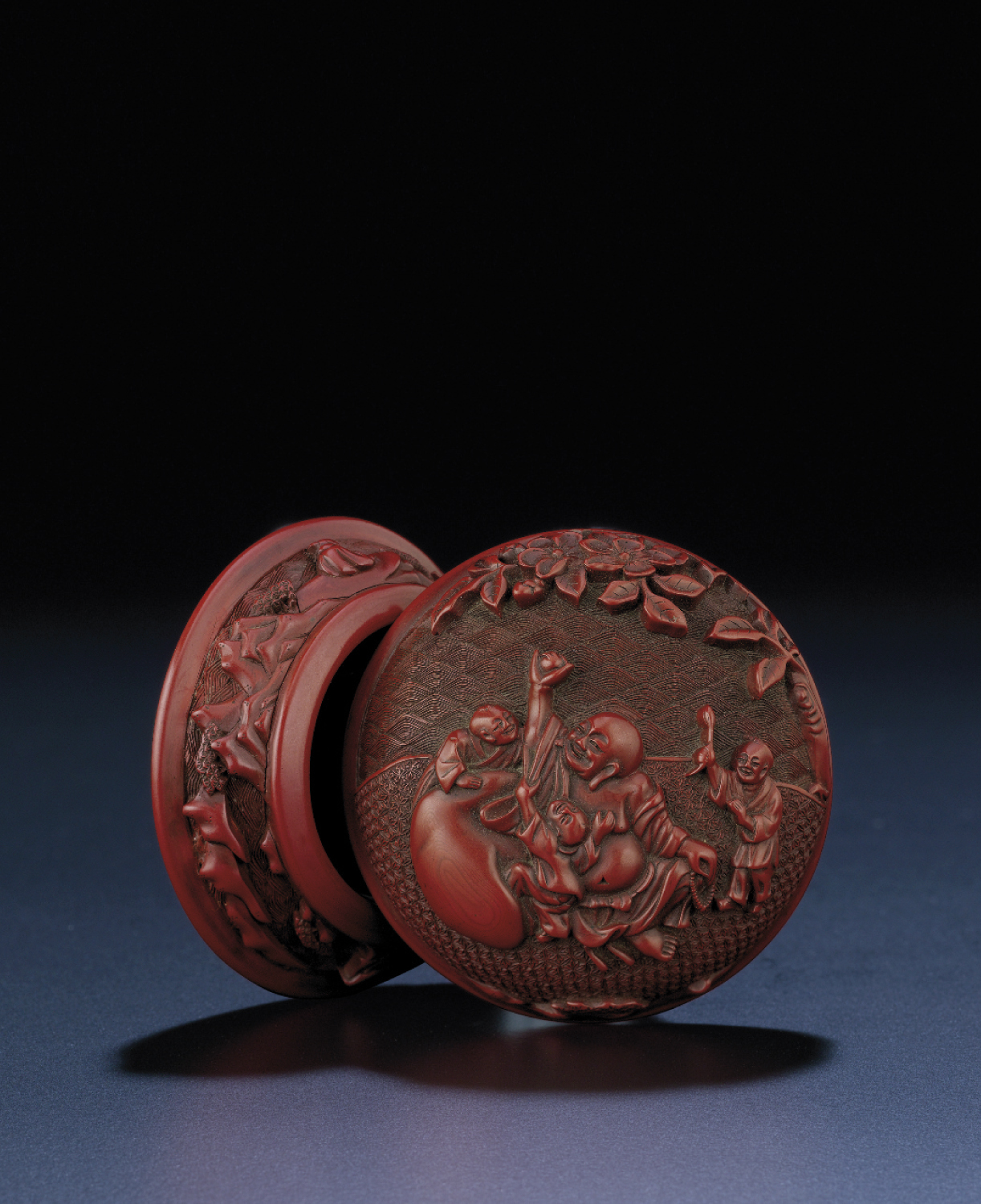 A MING CINNABAR LACQUER DOMED BOX AND COVER