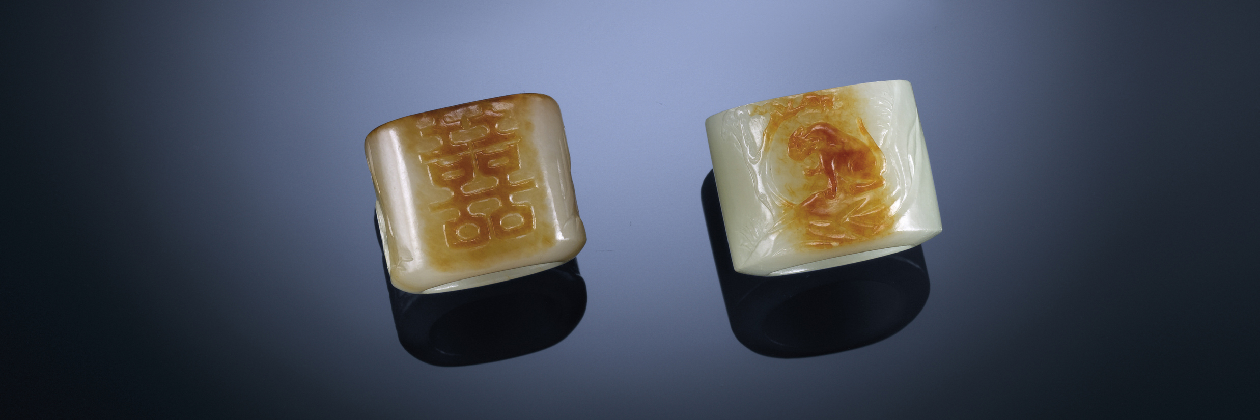 A GROUP OF FINELY CARVED WHITE JADE ARCHER'S RINGS