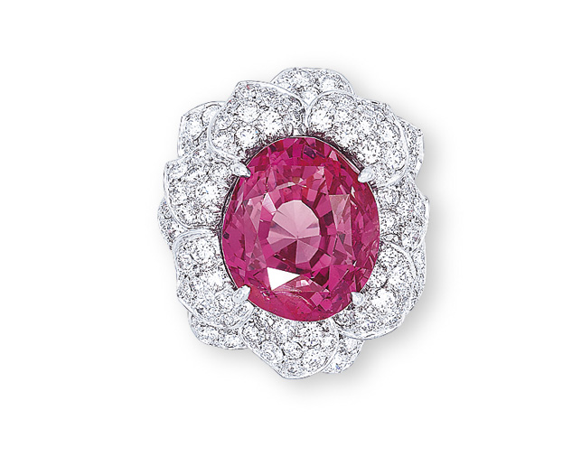 AN EXTREMELY RARE PADPARADSCHA SAPPHIRE AND DIAMOND RING, BY CARVIN FRENCH
