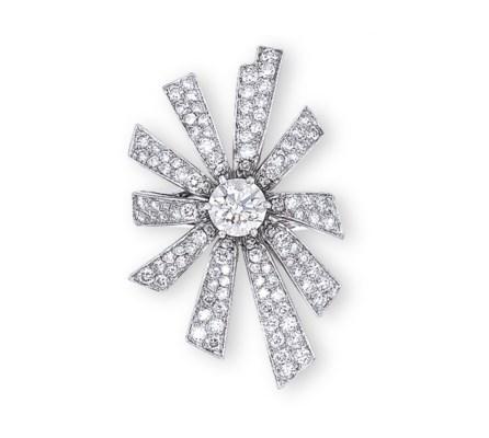 A DIAMOND 'SOLEIL' RING, BY CH