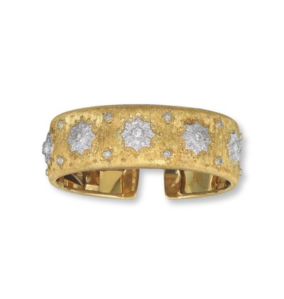 A GOLD AND DIAMOND BANGLE, BY