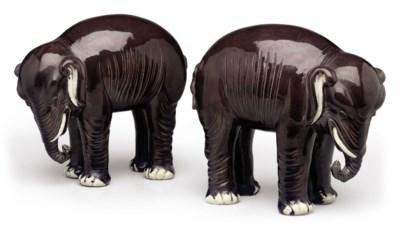 A PAIR OF AUBERGINE ELEPHANTS