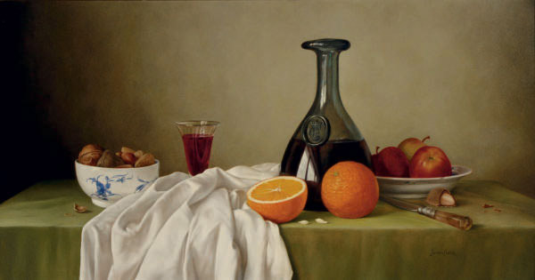 Still Life of fruit, wine and a bowl of nuts on a draped table