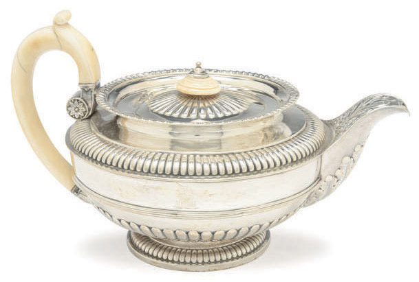 AN ENGLISH SILVER TEAPOT WITH HINGED COVER, IVORY HANDLE, AND FINIAL,