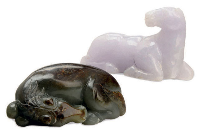 TWO CHINESE JADE FIGURES OF RECUMBENT HORSES,