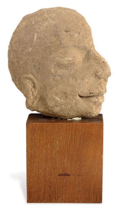 A STONE HEAD FRAGMENT,