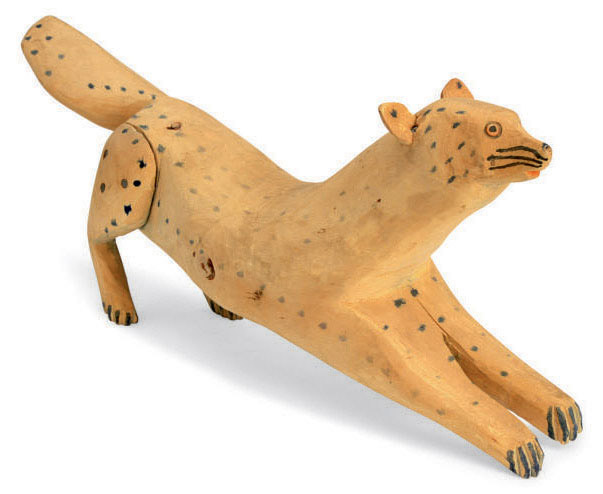 A FOLK ART CARVED AND PAINTED PINE FIGURE OF A SPOTTED SQUIRREL,