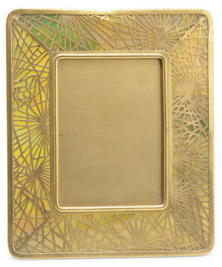 An American Gilt Bronze And Glass Pineneedle Picture Frame By