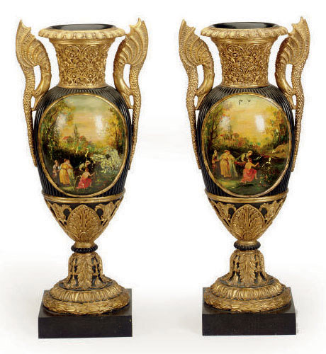 A PAIR OF POLYCHROME-PAINTED AND GILTWOOD TWO-HANDLED VASES,