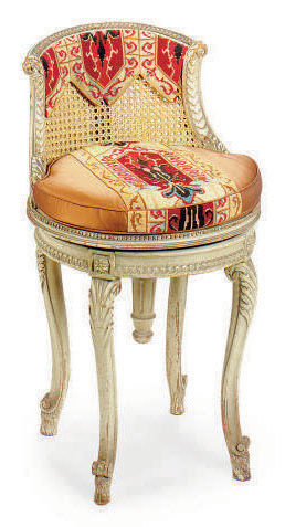 A FRENCH GREY-PAINTED AND CANED BOUDOIR CHAIR,