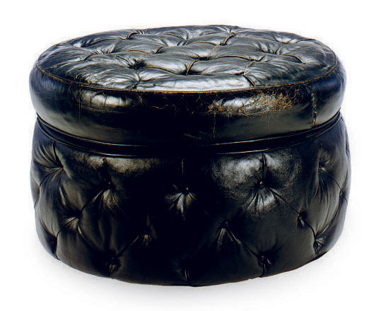 A BUTTON-TUFTED BLACK LEATHER-UPHOLSTERED CIRCULAR POUF,