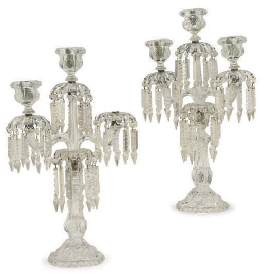 A PAIR OF VICTORIAN MOLDED AND CUT GLASS THREE LIGHT CANDELABRA,