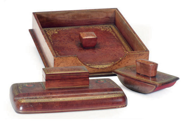 A PARCEL-GILT AND TOOLED RED LEATHER DESK SET,