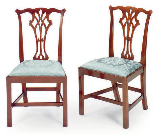 A SET OF EIGHT CARVED MAHOGANY SIDE CHAIRS,