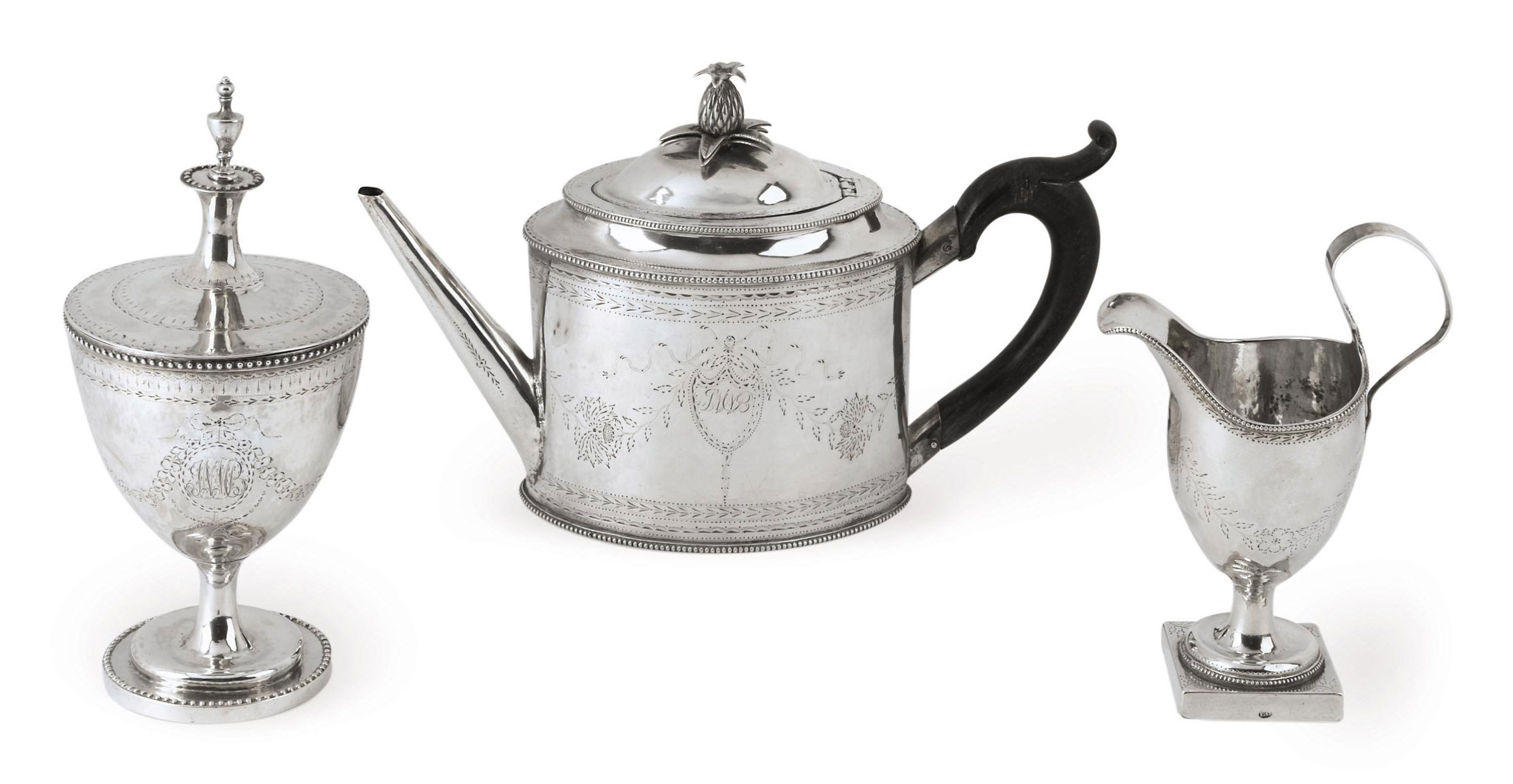 A SILVER THREE-PIECE TEA SERVICE