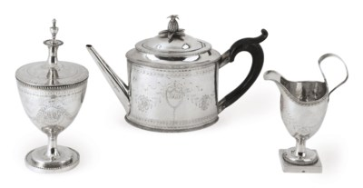 A SILVER THREE-PIECE TEA SERVI